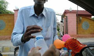 Poor man receiving water